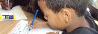 niño con lapiz