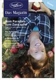 Frau im Gras liegend mit Aepfeln